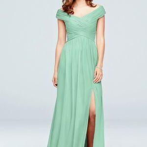 Green chiffon, off shoulder, floor length dress.